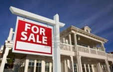 5853554-home-for-sale-sign-in-front-of-new-house